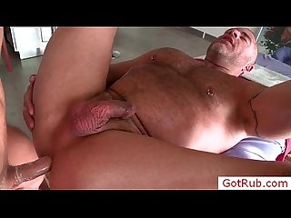 Muscled guy getting his dick rubbed by gotrub