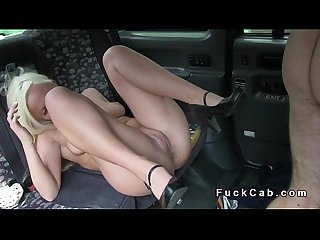 Blonde bangs in cab while laying on the side