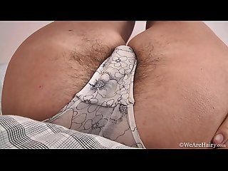 Eva masturbates while laying in bed