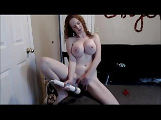 Busty redhead masturbates with sex toys on cam