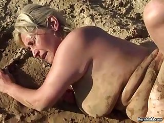Granny foursome fucking in the mud