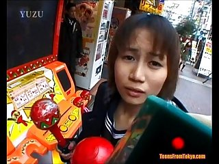 An asian teen is walking along the streets accompani from http alljapanese net