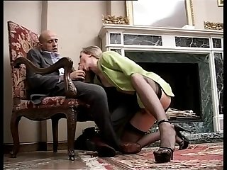 Classy and sexy girl in high heels and stockings sucking a cock