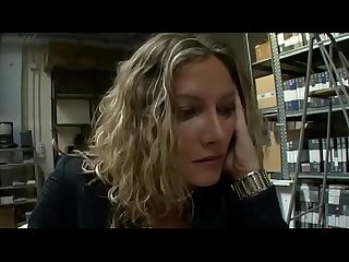 Sexy secretary screwed in a warehouse by a worker