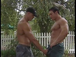 Two hunky men fucking on a pick up truck