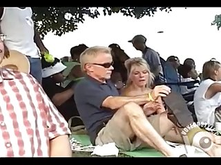 Casual upskirt in the park with a blonde milf