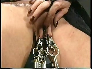 Horny beautiful slave with big boobs tied together got big clamps with weights on her pussy lips