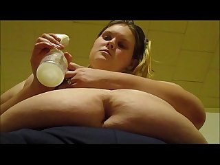 Sexy mom pumps breast milk from her huge milk filled tits