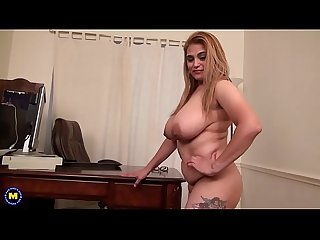 Busty mature masturbating in her office