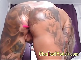 Sweet tattooed ass and pussy fucked with dildo