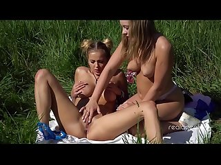 Two young Russian lesbians make 69 in the field
