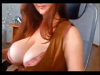 Busty redhead amazing tits
