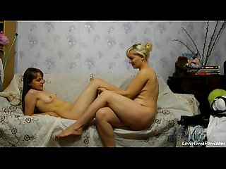 Two Sexy Girls Having Fun On A Couch