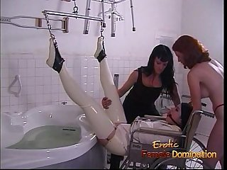 Latex-clad stunner pleasures her ass with a toy before receiving an enema