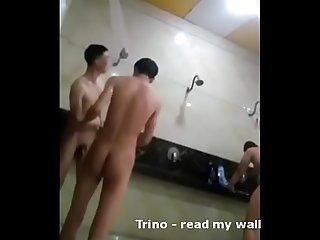 Asian boys in public shower