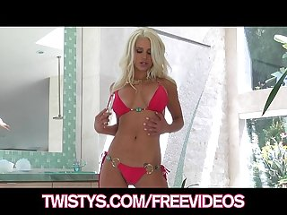 Busty blonde bikini babe plays with her new glass dildo