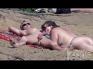 Blowjob on a nudist beach