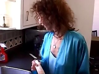 Hot redhead milf fucks on the kitchen