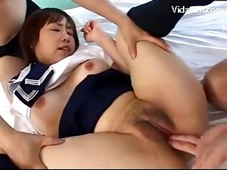Busty schoolgirl in uniform getting her tits rubbed pussy fingered sucking 2 guys cock on the bed
