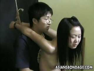 Asian Teen gets groped and poked by her nerdy master