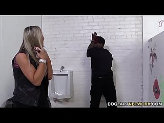 Abbey brooks assrides a black cock in a restroom