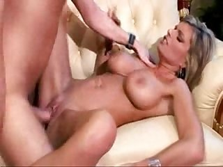 Hot blond milf gets fucked while getten a massage from a young guy