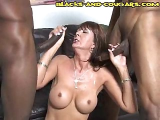Big tit milf takes two black cocks
