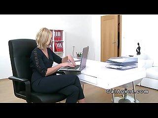 Blonde female agent licks pierced model