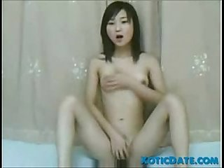 Young asian girl plays with her pussy xoticdate com