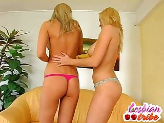 Beautiful blonde lesbian sluts have dildo fun and licking pussy
