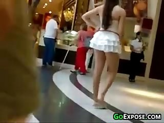 Girl at the mall wearing a short skirt
