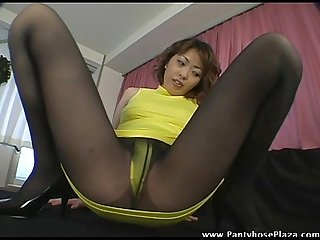 Horny mistress in pantyhose spreads to rub her pussy