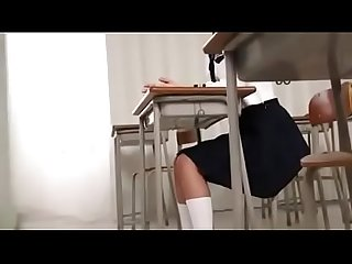 Cute Japanese school girl blows her teacher