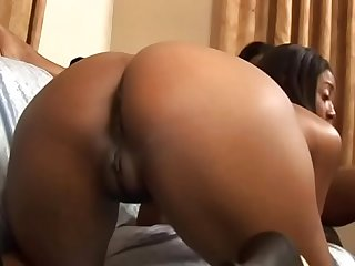 Ebony dyke Caren Caan penetrates her yonger femme Belle D'Leon's wet pussie with her big strap on