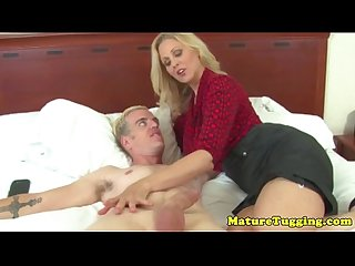 Busty cougar jerking dick and gets creamed on