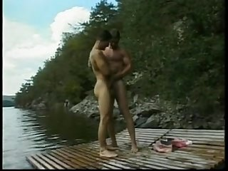 two hot men engage in hot sex on a lake